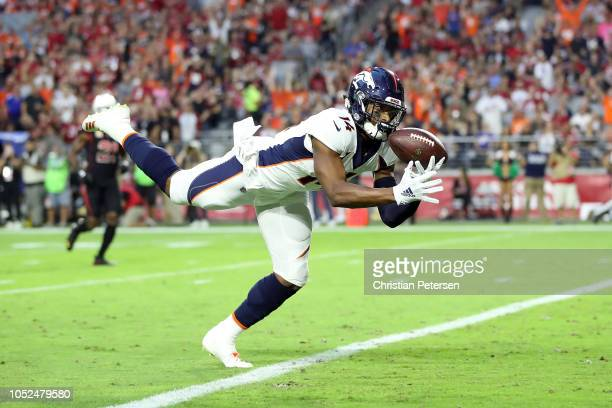 Wide receiver Courtland Sutton of the Denver Broncos scores a 28yard touchdown during the first quarter against the Arizona Cardinals at State Farm...