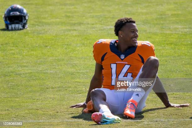 Wide receiver Courtland Sutton of the Denver Broncos smiles while stretching during a training session at UCHealth Training Center on August 17, 2020...