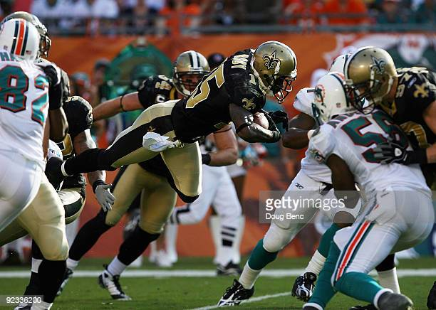 Wide receiver Courtney Roby of the New Orleans Saints goes airborne while returning a kick against the Miami Dolphins at Land Shark Stadium on...