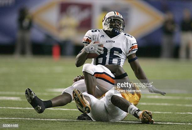 Wide receiver Courtney Taylor of the Auburn Tigers gets tackled during a play against the Tennessee Volunteers during the 2004 SEC Championship Game...
