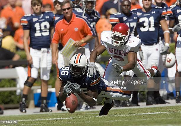 Wide receiver Courtney Taylor of the Auburn Tigers just misses a pass while being defended by Safety Kevin Woods of the Arkansas Razorbacks at...