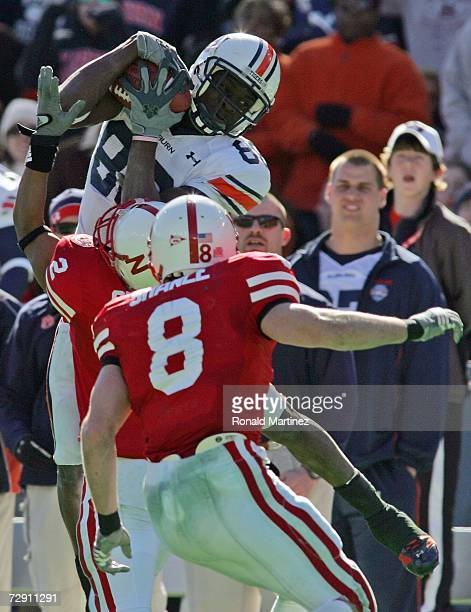 Wide receiver Courtney Taylor of the Auburn Tigers makes a catch against Cortney Grixby of the Nebraska Cornhuskers during the AT&T Cotton Bowl...