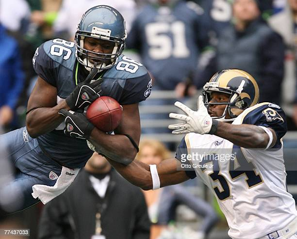 Wide receiver Courtney Taylor of the Seattle Seahawks attempts to catch an incomplete pass against Fakhir Brown of the St. Louis Rams at Qwest Field...