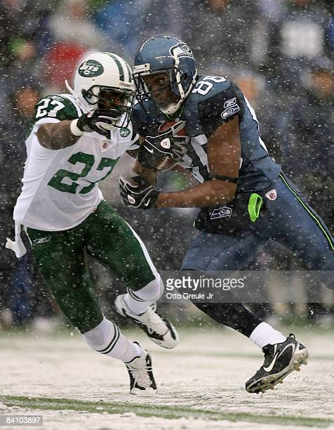 Wide receiver Courtney Taylor of the Seattle Seahawks rushes against Abram Elam of the New York Jets on December 21, 2008 at Qwest Field in Seattle,...