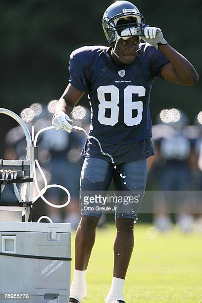 Wide receiver Courtney Taylor of the Seattle Seahawks takes a drink of water during training camp on July 31, 2007 at Seahawks Headquarters in...