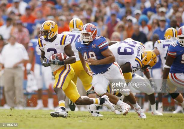 Wide receiver Craig Davis of the LSU Tigers runs with the ball pursued by defensive lineman Javier Estopinan of the Florida Gators at Ben Hill...