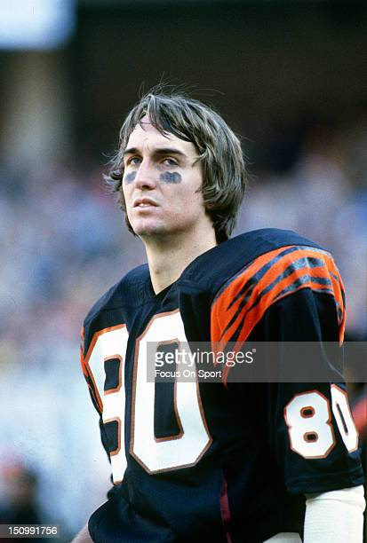 Wide Receiver Cris Collinsworth of the Cincinnati Bengals looks on from the bench during an NFL football game at Riverfront Stadium circa 1985 in...