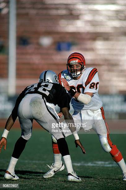 Wide receiver Cris Collinsworth of the Cincinnati Bengals makes a move to get around a Los Angeles Raiders defender during a 1985 NFL Season game at...