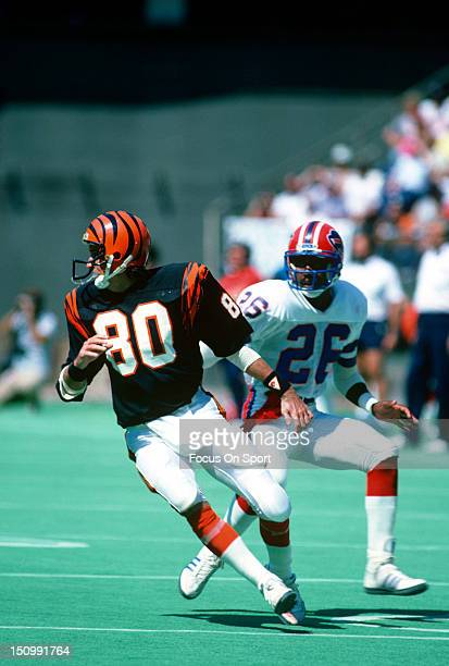 Wide Receiver Cris Collinsworth of the Cincinnati Bengals runs a pass rout guarded by Charles Romes of the Buffalo Bills during an NFL football game...