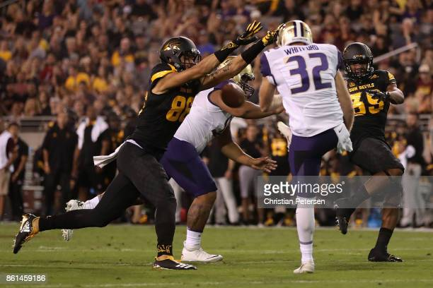 Wide receiver Curtis Hodges of the Arizona State Sun Devils blocks a kick from punter Joel Whitford of the Washington Huskies during the first half...