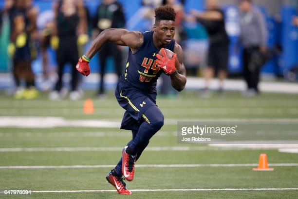Wide receiver Curtis Samuel of Ohio State runs after catching a pass during day four of the NFL Combine at Lucas Oil Stadium on March 4 2017 in...