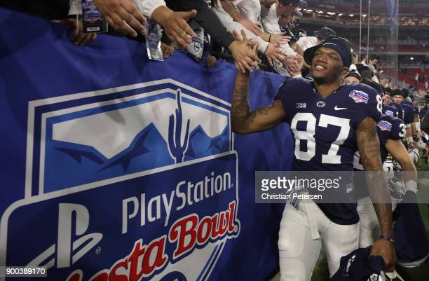 Wide receiver Dae'Lun Darien of the Penn State Nittany Lions high fives fans following the Playstation Fiesta Bowl against the Washington Huskies at...