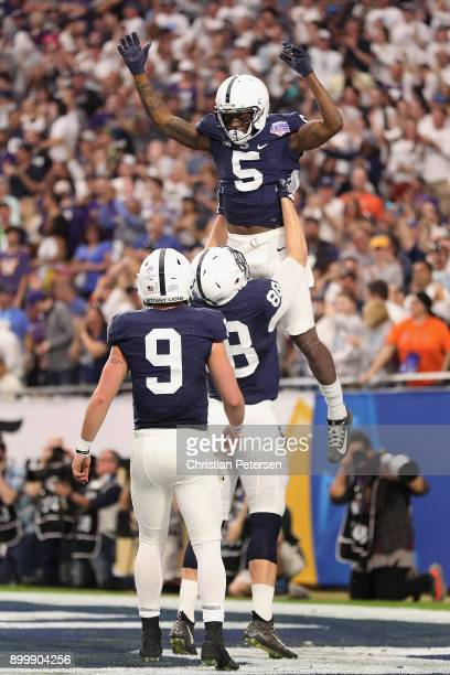 Wide receiver DaeSean Hamilton of the Penn State Nittany Lions Lions is hoisted in the air by tight end Mike Gesicki after Hamilton scored on a 48...