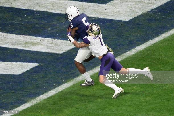 Wide receiver DaeSean Hamilton of the Penn State Nittany Lions runs in a 48 yard touchdown against defensive back Byron Murphy of the Washington...