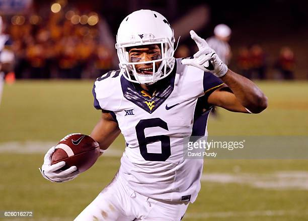Wide receiver Daikiel Shorts of the West Virginia Mountaineers celebrates as he scores a touchdown in the second half of play against the Iowa State...