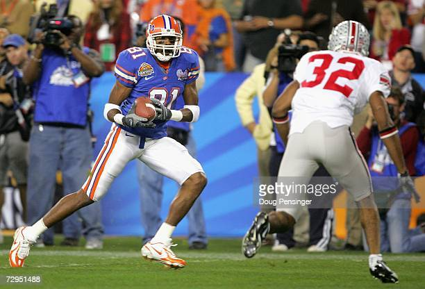 Wide receiver Dallas Baker of the Florida Gators carries the ball to score a 14 yard touchdown against Brandon Mitchell of the Ohio State Buckeyes...