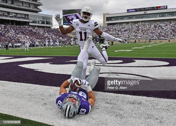 Wide receiver Dalton Schoen of the Kansas State Wildcats catches a touchdown pass against safety Jaquarius Landrews of the Mississippi State Bulldogs...
