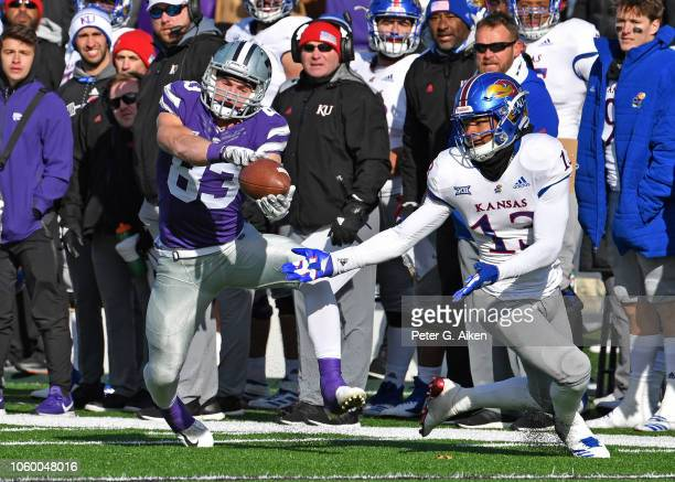 Wide receiver Dalton Schoen of the Kansas State Wildcats catches a pass for a first down against cornerback Hasan Defense of the Kansas Jayhawks...