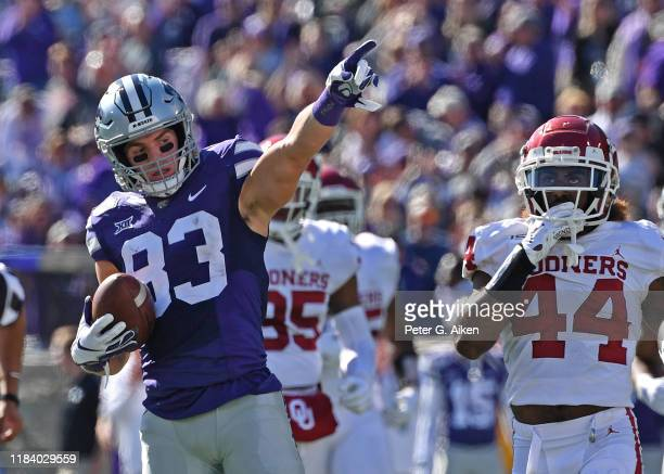 Wide receiver Dalton Schoen of the Kansas State Wildcats reacts after picking up a first down against the Oklahoma Sooners during the first half at...