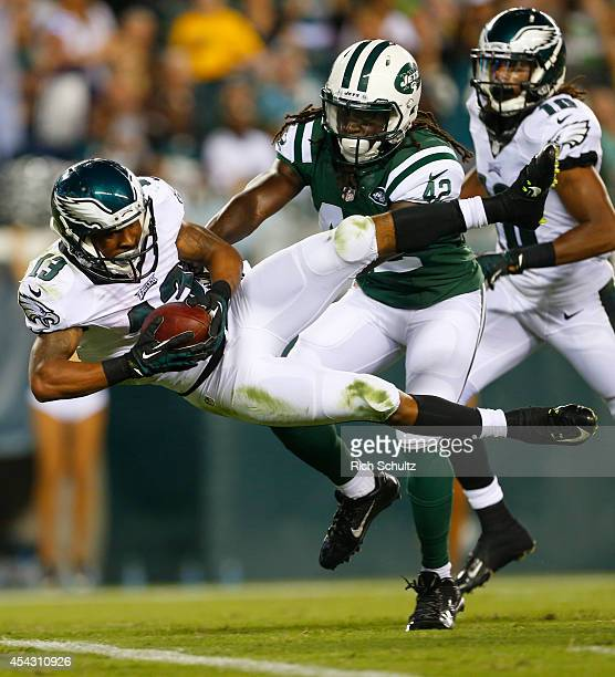 Wide receiver Damaris Johnson of the Philadelphia Eagles scores a touchdown in the preseason game against the New York Jets on August 28 2014 at...