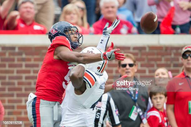 Wide receiver DaMarkus Lodge of the Mississippi Rebels attempts to catch a pass in front of defensive back Noah Igbinoghene of the Auburn Tigers...