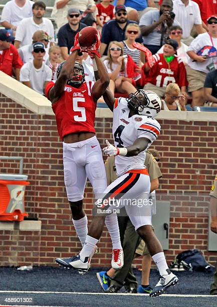 Wide receiver DaMarkus Lodge of the Mississippi Rebels catches a pass over defensive back Jaquille White of the Tennessee Martin Skyhawks for a...