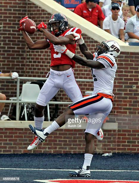 Wide receiver DaMarkus Lodge of the Mississippi Rebelscatches a pass over defensive back Jaquille White of the Tennessee Martin Skyhawks for a...
