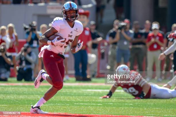 Wide receiver Damion Willis of the Troy Trojans runs after making a catch against the Nebraska Cornhuskers in the first half at Memorial Stadium on...