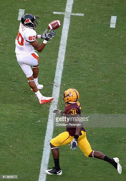 Wide receiver Damola Adeniji of the Oregon State Beavers makes a 41 yard reception past Pierre Singfield of the Arizona State Sun Devils during the...