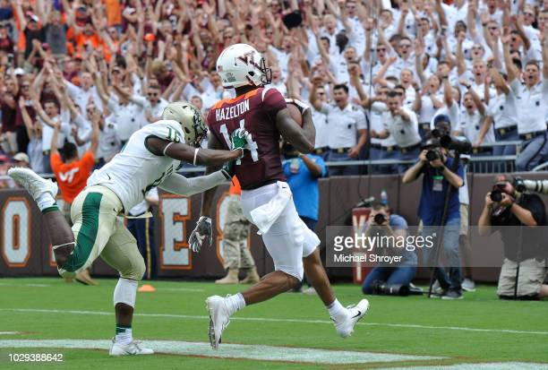 Wide receiver Damon Hazelton of the Virginia Tech Hokies catches a touchdown pass while being defended by cornerback Simeon Brown of the William Mary...