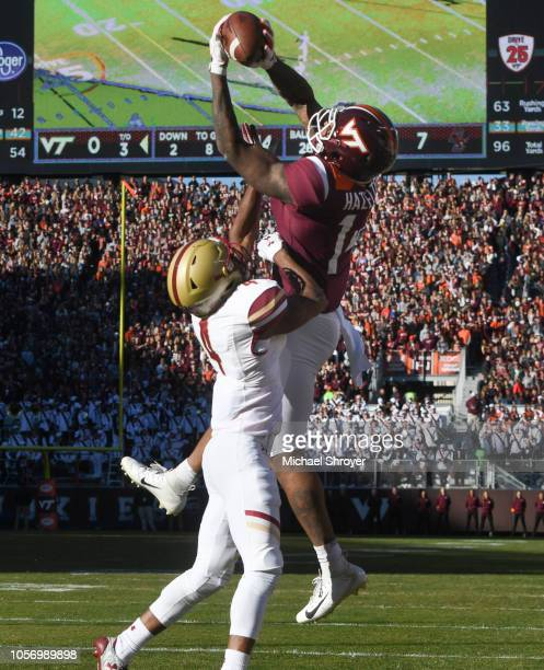 Wide receiver Damon Hazelton of the Virginia Tech Hokies catches a touchdown against the Boston College Eagles in the first half at Lane Stadium on...