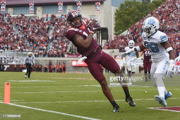 Wide receiver Damon Hazelton of the Virginia Tech Hokies catches a touchdown pass while being defended by defensive back Storm Duck of the North...