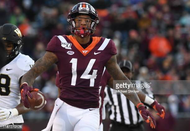 Wide receiver Damon Hazelton of the Virginia Tech Hokies is pushed out of bounds following his reception against the Wake Forest Demon Deacons in the...