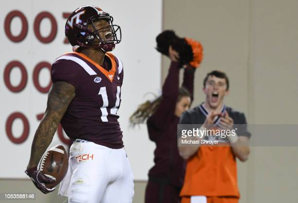 Wide receiver Damon Hazelton of the Virginia Tech Hokies reacts following his touchdown reception against the Georgia Tech Yellow Jackets in the...