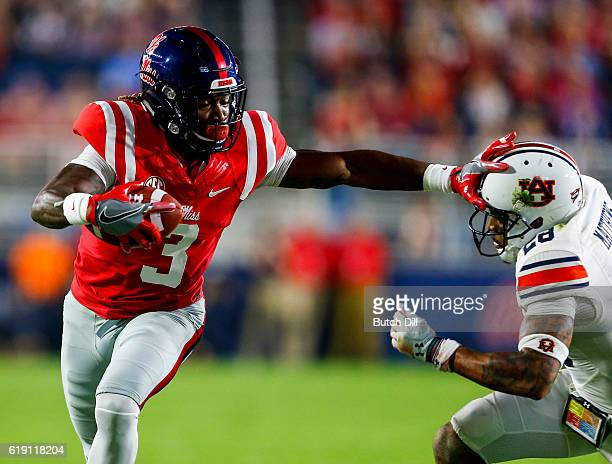 Wide receiver Damore'ea Stringfellow of the Mississippi Rebels stiff arms defensive back Tray Matthews of the Auburn Tigers as he carries the balls...