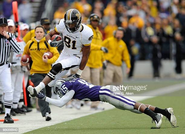 Wide receiver Danario Alexander of the Missouri Tigers leaps over defensive back Darious Thomas of the Kansas State Wildcats along the sidelines in...