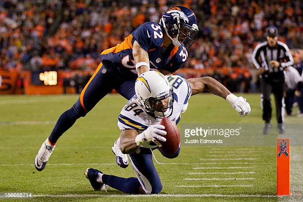 Wide receiver Danario Alexander of the San Diego Chargers reaches across the goal line for a touchdown as cornerback Tony Carter of the Denver...