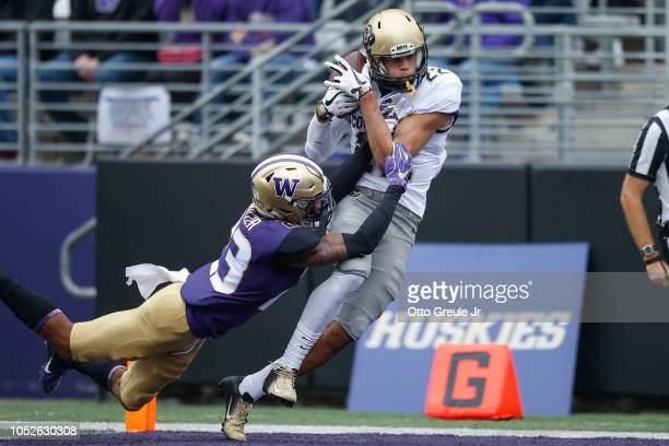 Wide receiver Daniel Arias of the Colorado Buffaloes makes a touchdown catch against defensive back Jordan Miller of the Washington Huskies at Husky...