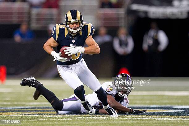 Wide receiver Danny Amendola of the St. Louis Rams runs after breaking breaking a diving tackle by defensive back Corey Graham of the Baltimore...