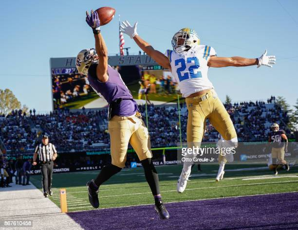 Wide receiver Dante Pettis of the Washington Huskies just misses making a touchdown catch against defensive back Nate Meadors of the UCLA Bruins at...