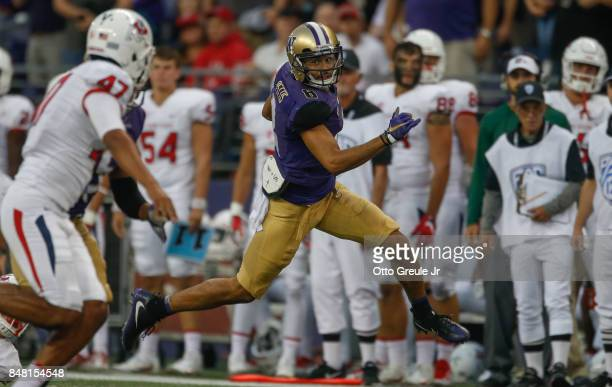 Wide receiver Dante Pettis of the Washington Huskies returns a punt for a touchdown against the Fresno State Bulldogs at Husky Stadium on September...