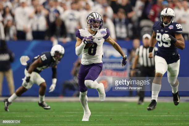 Wide receiver Dante Pettis of the Washington Huskies runs with the football after a reception against the Penn State Nittany Lions during the first...