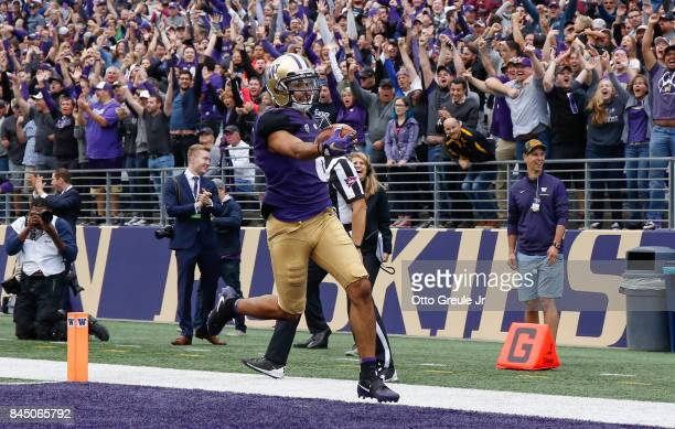Wide receiver Dante Pettis of the Washington Huskies scores on a 67yard punt return against the Montana Grizzlies at Husky Stadium on September 9...