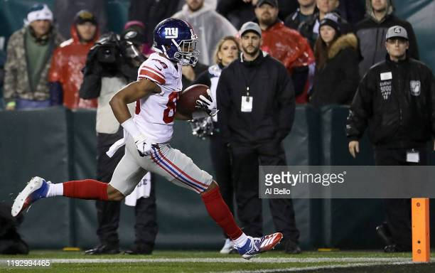 Wide receiver Darius Slayton of the New York Giants runs in a pass for a touchdown in the second quarter of the game against the Philadelphia Eagles...