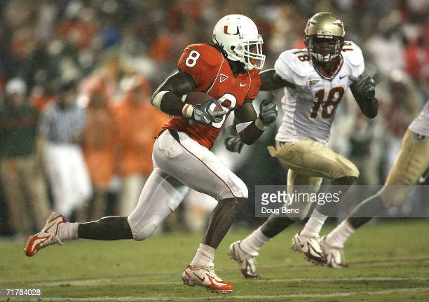 Wide receiver Darnell Jenkins of the University of Miami Hurricanes tries to get past cornerback J.R. Bryant of the Florida State Seminoles at the...