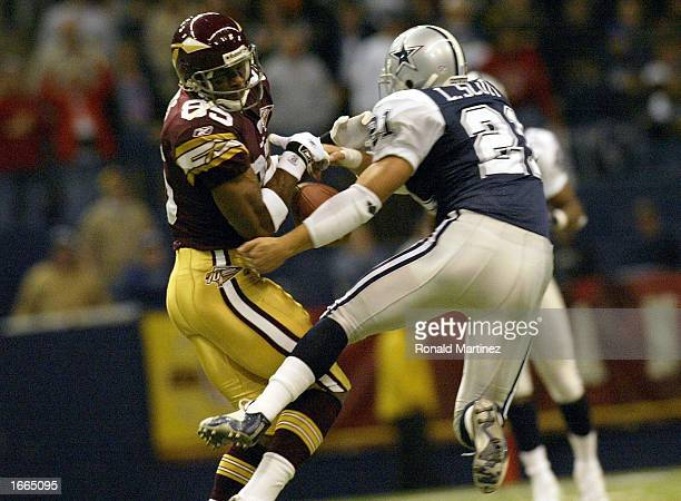 Wide receiver Darnerien McCants of the Washington Redskins has a catch attempt broken up by Lynn Scott of the Dallas Cowboys on November 28 2002 at...
