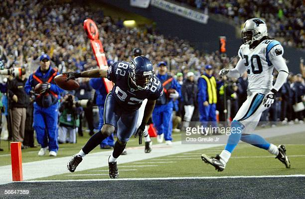 Wide receiver Darrel Jackson scores a touchdown in third quarter action as cornerback Chris Gamble of the Carolina Panthers watches during the NFC...