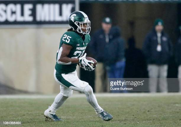 Wide receiver Darrell Stewart Jr #25 of the Michigan State Spartans carries the ball against the Rutgers Scarlet Knights during the first half at...