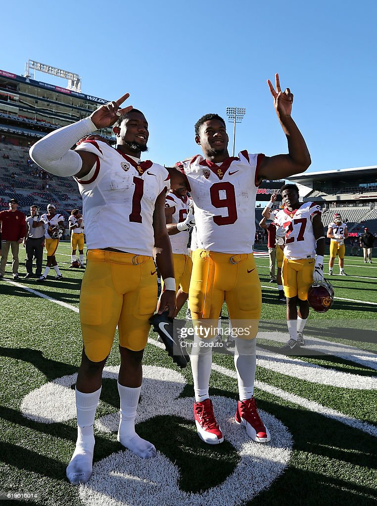 Wide receiver Darreus Rogers #1 (left) and wide receiver JuJu Smith-Schuster #9 of the USC Trojans sing the fight song after the college football game against the USC Trojans at Arizona Stadium on October 15, 2016 in Tucson, Arizona. USC won 48-14.