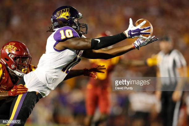 Wide receiver Daurice Fountain of the Northern Iowa Panthers can't hold onto a touchdown pass as he is tackled by defensive back Brian Peavy of the...